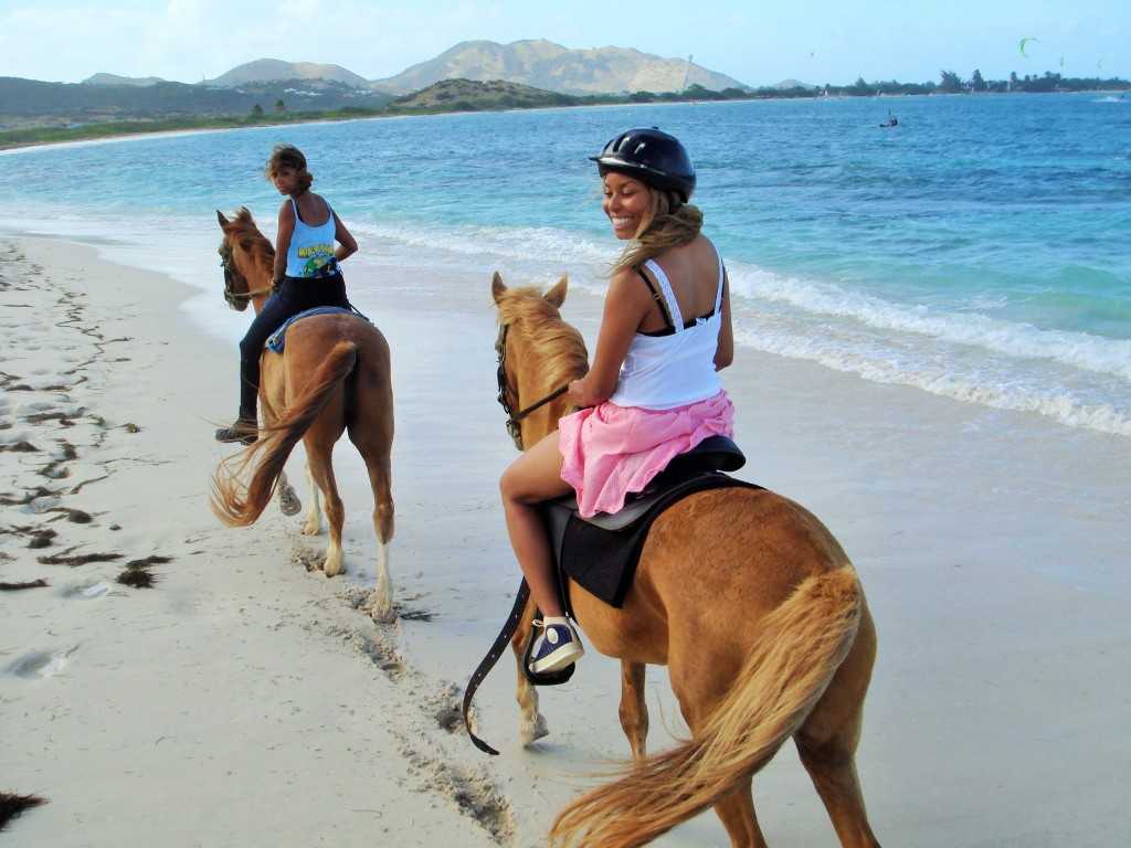 Africah Horse-back riding on the beach.